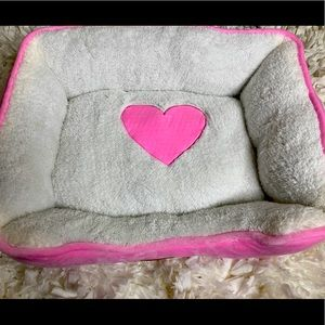 Small pink and white dog bed